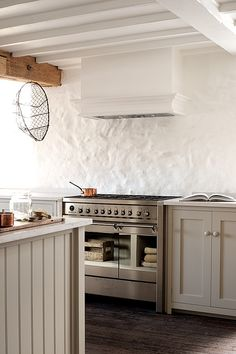 This kitchen is painted in deVOL's 'Mushroom' paint colour with Silestone worktops, a perfect combo.