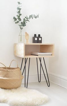 Mid century wooden nightstand with eucalyptus.