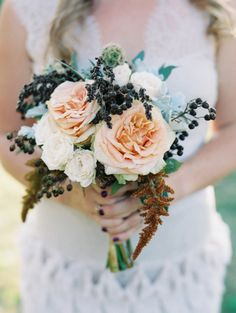 Rustic bridesmaid bouquet: http://www.stylemepretty.com/missouri-weddings/st-louis/2014/12/08/romantic-fall-wedding-at-the-missouri-history-museum/ | Photography: Clary Pfeiffer - http://www.claryphoto.com/
