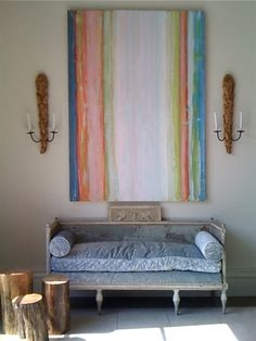 magnificent sofa.  Old velvet, down rumpled cushion.  The art...placement of sconces  via www.amberinteriordesignblogspot.com