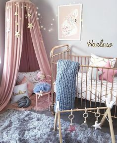 I have a new favourite  this swan print from @schmooksart was custom made in dusty pinks, greys and gold to match Harlow's nursery! _ And how gorgeous are these 'Lunar Lux' play gym toys, soon to be released at @lilah_and_co ⭐️ _ #nursery #girlsnursery #girlroom #babygirl #rosegold #dustypink #decor #decorforkids #kidsroom #kidsstyle #interiorstyling #nurseydecor #nurseryinspo #kidsroom #numero74 #kmart #kmartaddictsunite #kmartstyling #playgym #print #handmade #swan