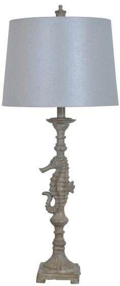 Create a captivating beach cottage style with this 32 inch tall sand colored dancing seahorse table lamp.