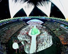 Confetti shoots from Olympic Rings on the stage and fireworks forming the Olympics Rings are set off during the Opening Ceremony of the Rio 2016 Olympic Games at Maracana Stadium on August 5, 2016 in Rio de Janeiro, Brazil.