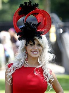 HA HA HA! I never want to offend anyone with any of my posts. But I sure hope someone told her that her hat looks like two dead crows surfing a bloody wave. Ascot Hats: Ladies Day