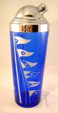 Cobalt blue glass Cocktail Shaker, sailing flags motif, made by Hazel Atlas in the 1930s.