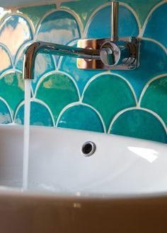 Aquamarine is so soothing.  These tiles have a hand made feel and look that never gets old.