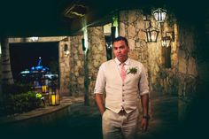 Groom in Tan Suit and Pink Tie | Photography: Juan Carlos Tapia Photography. Read More:  http://www.insideweddings.com/weddings/rustic-destination-wedding-with-touching-details-on-beach-in-mexico/801/