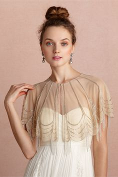 Trickling Capelet from BHLDN beautiful, I love the drapey look with the beading, and the color is perfect. I think it tones down the formal look of the wedding dress, moderinizing it, while also keeping the antique look.