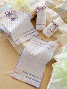 Baby Gift Set FREE crochet bottle covers, bib and burp cloth pattern download. Find this pattern at Free-Crochet.com.
