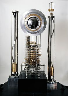 10,000 Year Clock: TIME MACHINE: The 10 000-Year Clock [prototype shown here] is a monumental timepiece designed to tell time for ten millennia. Its first components are now being machined and tested.