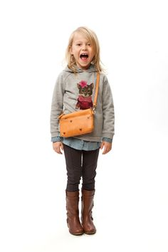 Nice things mini will be at Little Barcelona. graphic hoodie layered over woven w/ skinny jeans and tall boots