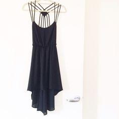 Tobi Black Cutout-Back Dress 100% NEW!!! Never been worn! Little black dress. Hi-Lo hem line. Cut out details on the back. Really pretty!! Can ship same-day! Tobi Dresses
