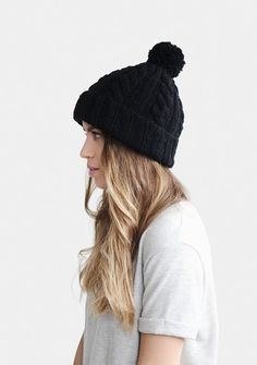afb2257156a Hand knitted unisex beanie hat with handmade pom pom. Made with a wool  blend and