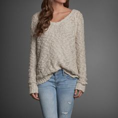 Supersoft, relaxed v-neckline, classic knit with soft & pretty texture, logo engraved metal charm, Easy Fit, Imported | abercrombie.com