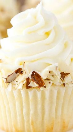 Almond Amaretto Cupcakes ~ A moist almond cupcake, almond frosting and a fluffy white chocolate amaretto center!