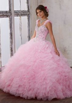 Made From Ruffled Petal Organza this Quinceañera Ballgown Features a Sweetheart Bodice with Jeweled Beading and Removable Floral Straps. Corset Back. Matching Stole