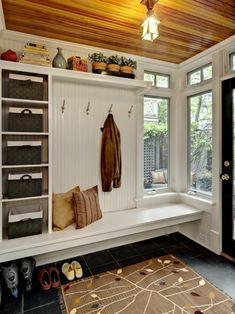 mudroom inspiration - straight bench with baskets underneath for shoes, upper cabinets or shelves/baskets for outer gear and top shelf for decor
