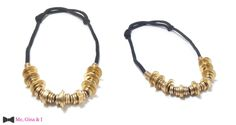 Brass washer necklace with black rope.
