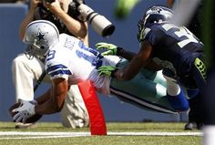Dallas Cowboys' Miles Austin, left, dives into the end zone for a touchdown as Seattle Seahawks' Brandon Browner follows in the first half of an NFL football game on Sunday, Sept. 16, 2012, in Seattle. (AP Photo/Kevin P. Casey)
