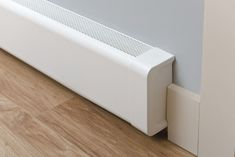 The aluminum Titan Baseboard Cover Straight Kit comes in lengths from ft. Install in minutes. Buy your new baseboard cover online today! Hydronic Baseboard Heaters, Electric Baseboard Heaters, Baseboard Heating, Baseboard Radiator, Baseboard Heater Covers, Baseboards, Modern Modular Homes, Rustic Living Room Furniture, Old Shutters