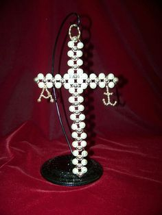 Alpha and Omega Cross represents Jesus as Beginning and End