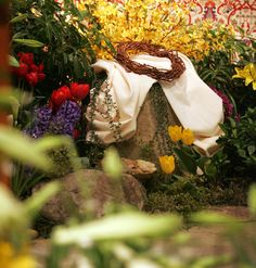 decorating church with potted easter plants | ... flowers decorate the altar at St. Joseph the Worker Church in Orefield
