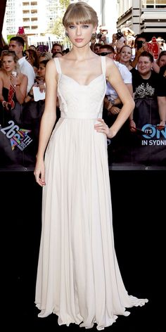 Swift swept into Sydneys Aria Awards in a peek-a-boo lace Elie Saab gown and cluster studs.