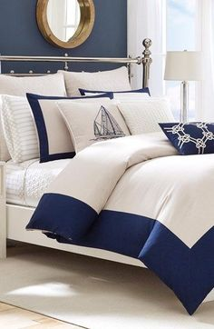 Nautical vibes! Love this blue and white bed set paired with boat print pillows.
