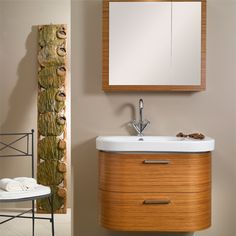 Rounded vanity, available in grey oak.