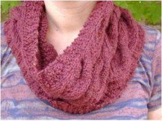 This free knitting pattern has a lace and cable design that continues around the neck and creates a cozy and comfy cowl. This pattern is fully charted with descriptions of the abbreviations at the bottom of the chart and is designed for experienced beginners or advanced knitters who are familiar with basic terms and knitting cables.