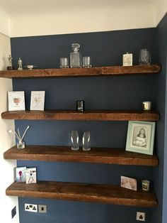 Chunky floating shelves are a great way to add something to that empty alcove without investing in a huge dresser (less to dust) and till give it that openness These were from House Of Rustic (Amazon)