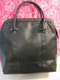WOMENS    BLACK FAUX LEATHER    TOTE/SATCHEL/WEEKENDER    MINT CONDITION    FOR PREOWNED    13 IN HEIGHT    16.5 IN LENGTH    12.5 IN DEEP    6 IN STRAP DROP    VERY ROOMY    VERY CLEAN    VERY STYLISH    SUPER CUTE    WONDERFUL ADDITION    TO YOUR WARDROBE
