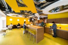 Workplace and workspace ideas and also workplace externa designl types illustrate exemplary google interior style in bold yellow feel to match using real wood home furniture finished that has decorative pendant lamps installed