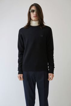 Acne Studios Nalon Face black is a classic fit crewneck pullover sweater with an embroidered face patch. The Face collection is unisex and is based on mens sizing.