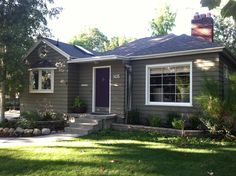 Warm grey house, purple door
