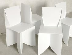 Origami Style: Paper-Thin, Patio-Ready White Folding Chairs