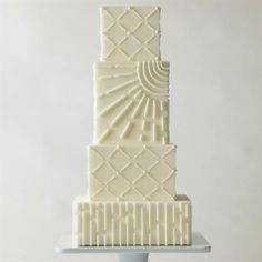 Looking for a simple wedding cake with a touch of intricacy? A piped graphic pattern adds depth and deliciousness to every square tier of this fresh and modern design. Summer Wedding Cakes, Amazing Wedding Cakes, White Wedding Cakes, Elegant Wedding Cakes, White Cakes, Amazing Cakes, Plum Wedding, Elegant Cakes, Wedding Cakes