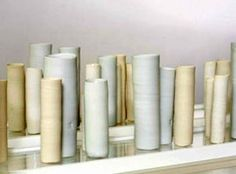White and cream porcelain cylindrical vessels.