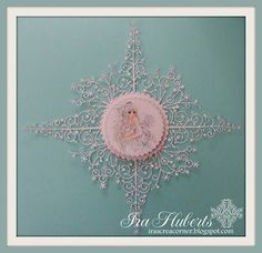 This is so cool.  This designer used the snowflake tree four times around the angel.
