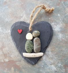 ****To ensure delivery in time for Christmas, All custom orders to be received by 9th December. All other orders to be received by 16th December.**** These are beautiful and unique handmade beach pebble art picture of pebble people sitting on driftwood with red wooden heart embellishment