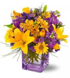 As vibrant as the sky over Tucson. This stunning contemporary cube vase overflows with yellow and lavender flowers, like sunshine emerging through morning clouds. A spectacular floral gift that will take their breath away. Yellow Wedding Flowers, Lavender Flowers, Orange Flowers, Love Flowers, Beautiful Flowers, Sun Flower Wedding, Colorful Flowers, Summer Wedding, Wedding Flower Arrangements