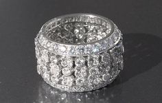 Rare 1980s Cartier Parure, made in France and set with round diamonds. The ring is size 6.25, and has 204 diamonds weighing approximately 4.68 carats.