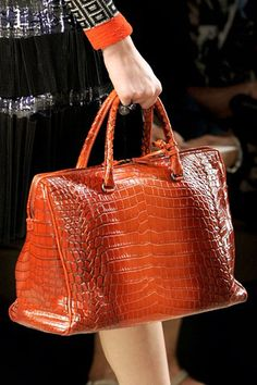 865f69370c85 Bottega Veneta s signature crocodile-leather bag is a bag one has to own in  her wardrobe as it is pretty versatile