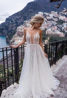 Aime is a beautiful full wedding gown. Stunning embroided lace on a beautiful tulle fabric. Low neckline with delicate straps and low back. This beautiful gown is only available at Luella's Bridal.