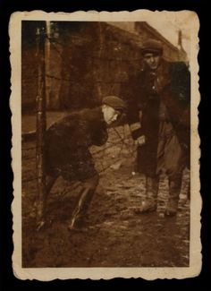 "Jan Kostanski, a Polish teenager, assisted the Wierzbickis, a Jewish family he knew well as neighbors before the war. After German authorities confined the Wierzbickis in the Warsaw ghetto, Kostanski smuggled food to them.  In this 1942 photo, Jan is entering the ghetto through a barbed-wire fence. When the Germans began deportations from the ghetto, Jan helped bring several members of the Wierzbicki family to safety on the ""Aryan"" side of Warsaw, where his mother found them hiding places."