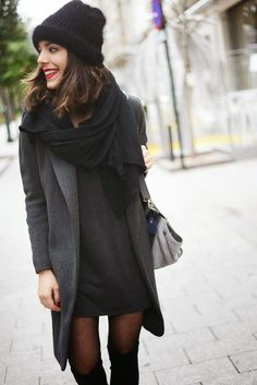 Black toque, black scarf, grey coat, black dress, tights, boots
