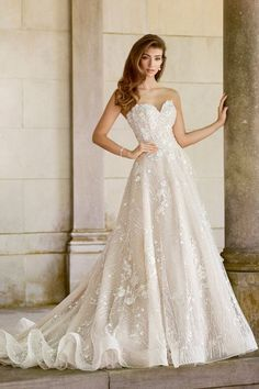 Romantic wedding dress idea - a-line wedding dress with strapless neckline and 3D appliques. Style 118281 by Martin Thornburg. Find more #weddingdress inspo from Mon Cheri on WeddingWire!
