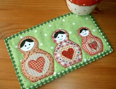 Russian Nesting Dolls Mug Rug pattern $1.99 on Craftsy at http://www.craftsy.com/pattern/quilting/home-decor/russian-nesting-dolls-mug-rug/42225