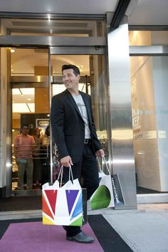 Eddie Cibrian gets a little shopping help from the Playboy bunnies