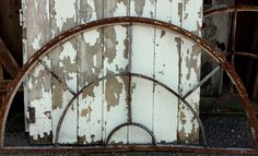 Stunning antique wrought iron window transom/guard out of an old 1936 building in Tennessee. This beautiful piece of old architecture has a beautiful patina and can be used in so many ways. Fantastic over a door or as a wall hanging, we have 3 available at present. Measurement: 75 inches long, 38 inches tall at center Please feel free to message us with any questions and we will get right back to you;) SHIPPING: Please message us with your location for best estimated fee. The fee listed m...